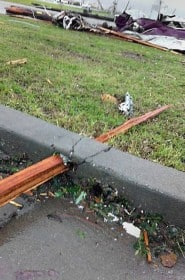 Picture of a board that pierced cement during tornado
